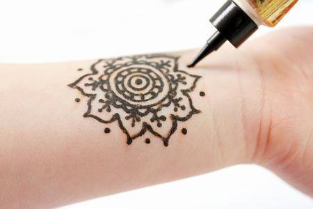Image of henna ornament on girl's wrist closeup Stock fotó