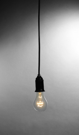 Light bulb on grey background