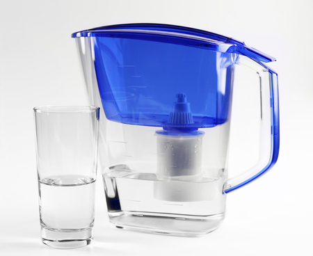 Blue water filter with glass on grey background Banque d'images