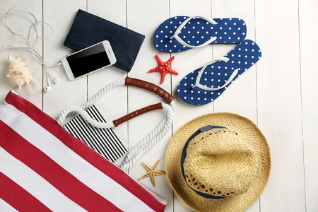 Beach accessories on wooden background Фото со стока