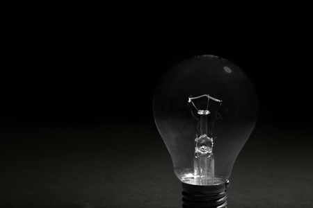 Electric bulbs on dark grey background