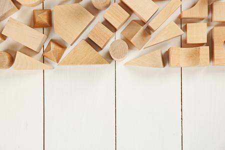 Wooden children's cubes on white wooden background Reklamní fotografie