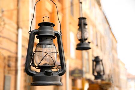 Hanging old lanterns on blurred background