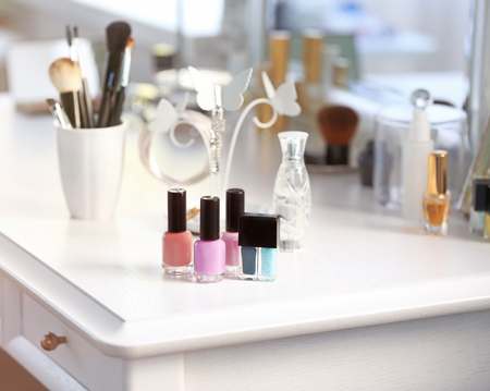 Nail polish set on light dressing table Stock Photo