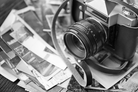 Vintage photos with camera, close up. Black-and-white image