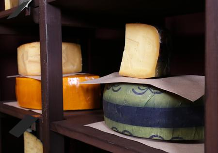 Fresh cheese on the shelf in cellar