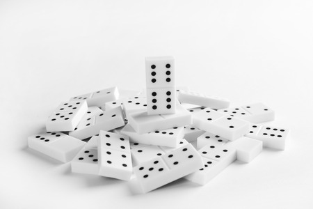 Heap of dominoes, isolated on white Reklamní fotografie