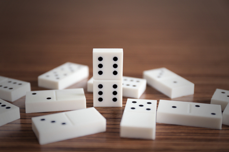Heap of dominoes on wooden background Reklamní fotografie