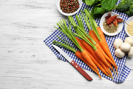 Carrots with vegetables and spices on wooden table 版權商用圖片