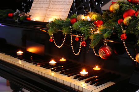 Piano keys with Christmas decorations, closeup