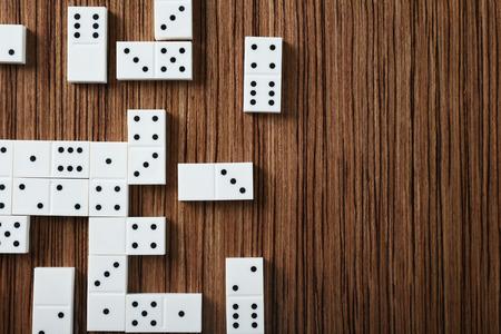 Heap of dominoes on wooden background 免版税图像