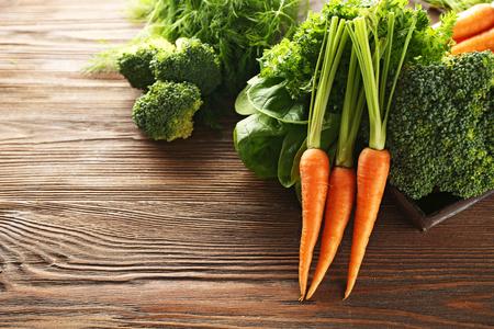 Carrots and broccoli on wooden table 版權商用圖片