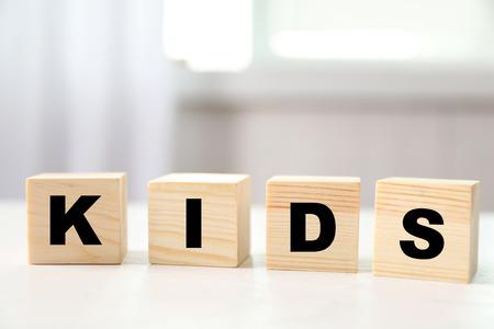 Word KIDS on light background