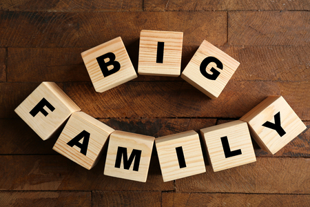Words BIG FAMILY on wooden background