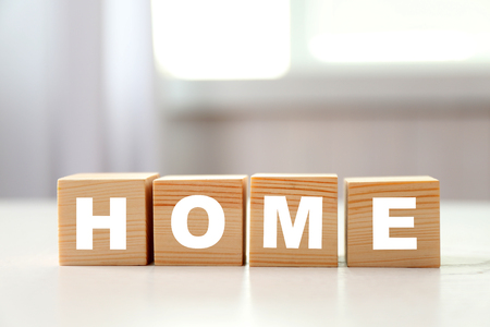 Word HOME on light background
