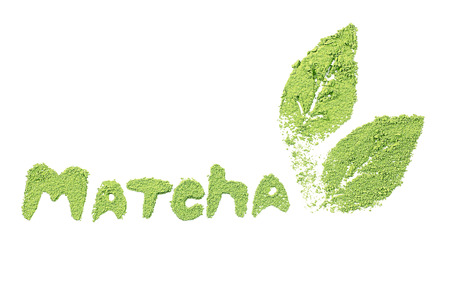 Matcha word by powdered matcha green tea, isolated on white Stock Photo