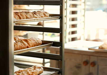 Strudels on shelving in bakery Stock Photo