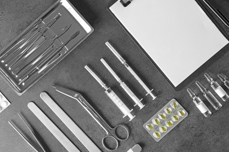 Medical tools set on dark gray background Standard-Bild