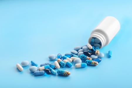 Heap of pills on blue background