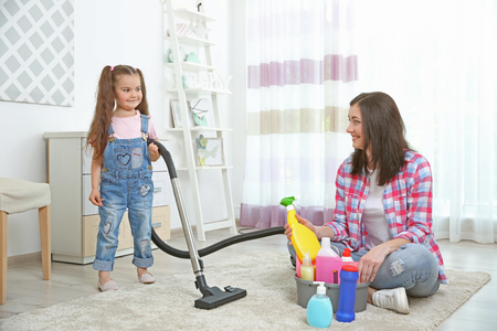 Daughter and mother cleaning house together