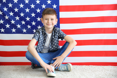 Boy on American flag background