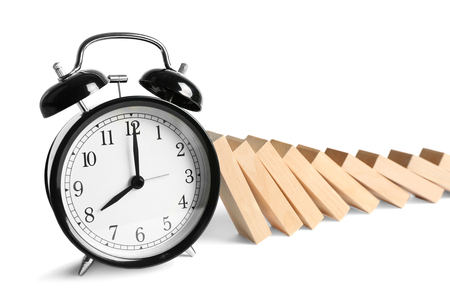 Wooden blocks and clock isolated on white