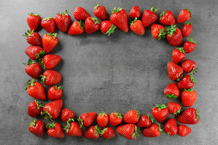 Strawberries frame on grey background 写真素材