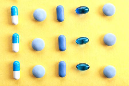 Heap of pills on yellow background 版權商用圖片