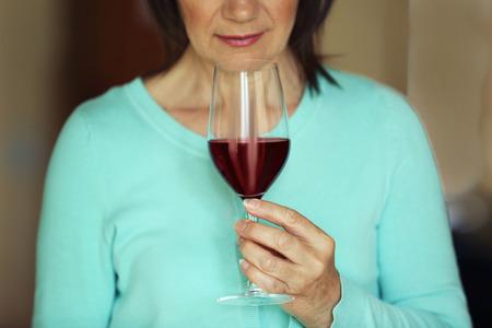 Woman tasting red wine 写真素材