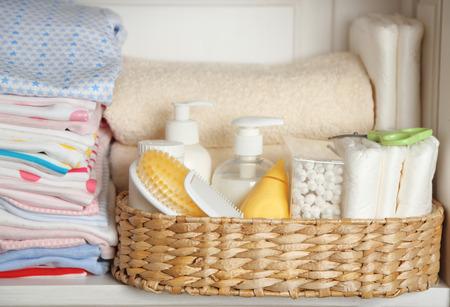 Set of baby hygiene accessories on shelf
