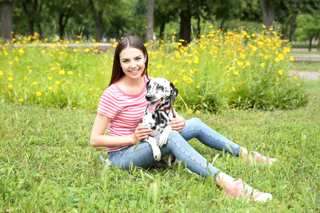 Owner with her dalmatian dog outside