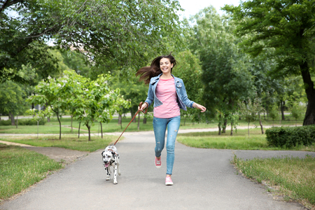 Owner with her dalmatian dog walking outdoors Stockfoto