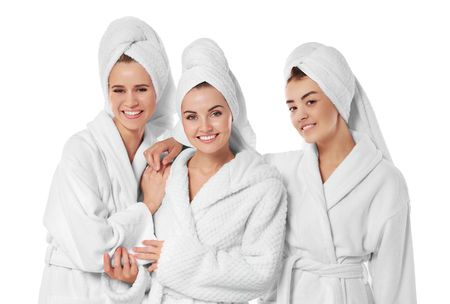 Three beautiful women in dressing gowns isolated on white Standard-Bild