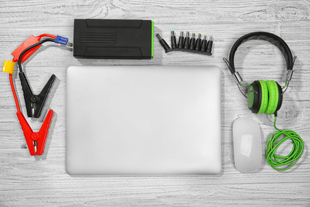 Laptop with accessories. Energy and information safety concept Foto de archivo
