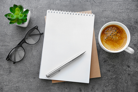 School notebook with glasses and coffee on table 免版税图像