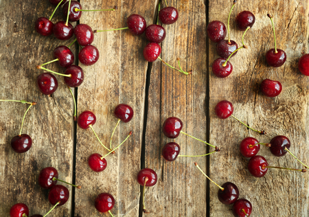 Fresh ripe cherries on wooden background Stock fotó