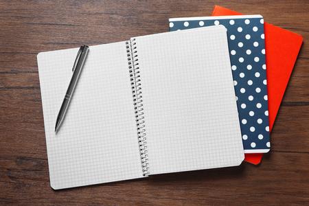 School notebooks on wooden background