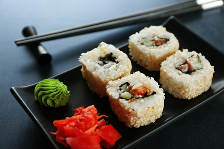 Sushi roll set in black plate, close up 写真素材