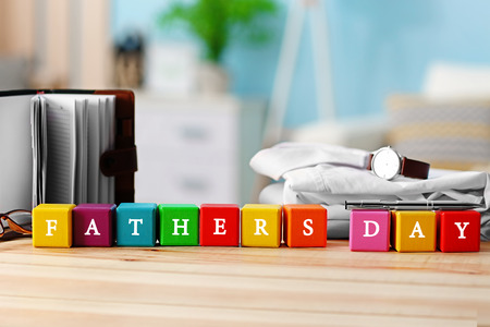 Wooden cubes on light background. Happy fathers day concept