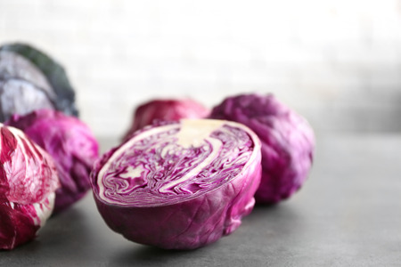 Red cabbage on brick wall background