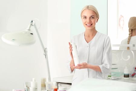 Cosmetologist holding cream