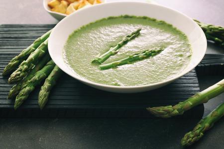 Tasty asparagus soup on table Stock fotó