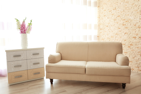 Interior with furniture and decorative flowers Stock Photo