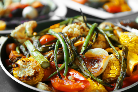 Grilled vegetables in frying pan, close up