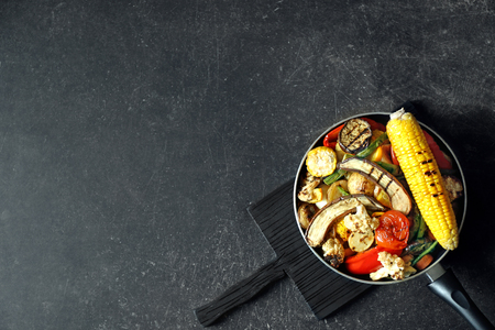 Grilled vegetables in frying pan on the table