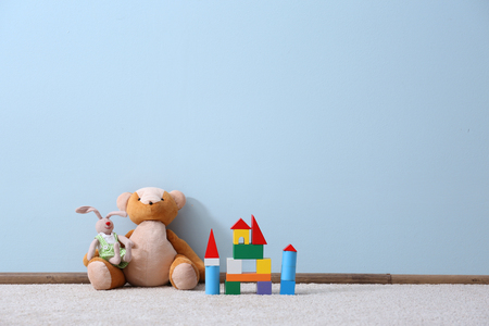 Different toys on blue wall background Imagens