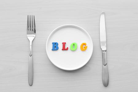Blog word on plate. Food blog concept 版權商用圖片