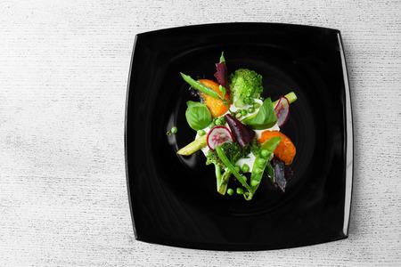 Grilled vegetable salad on black plate