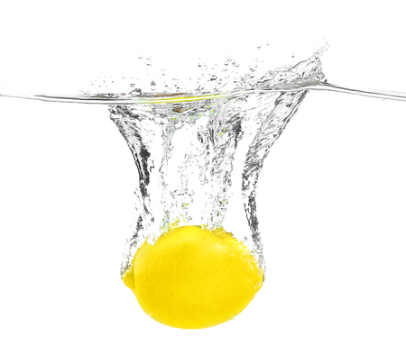 Lemon in water on white background 写真素材