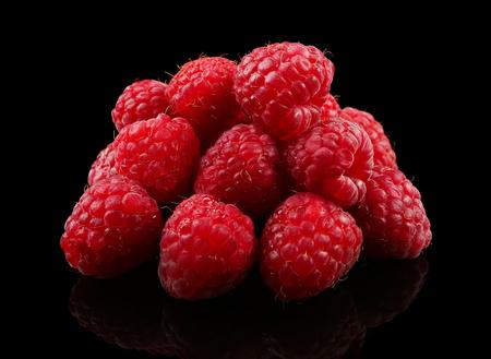 Fresh raspberries on black background Stok Fotoğraf